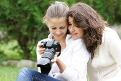 Two girl looking with digital camera royalty free stock photos