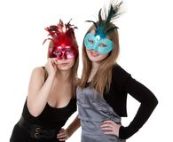 Two girl in the masquerade mask Stock Images