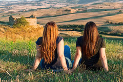 Two girl on meadow Royalty Free Stock Image