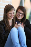 Two_Girl_Phone Royalty Free Stock Image