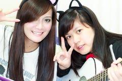Two girl Playing Guitar Stock Photo