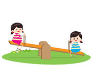 Two girl playing riding on seesaw Stock Images