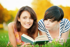 Two girl read a book Royalty Free Stock Image