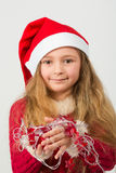 Two girl in a red dress and caps Santa Claus Royalty Free Stock Photo