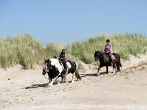 Two girl riding on a horse on the beach Royalty Free Stock Photography