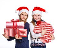 Two girl in Santa's hat with gift box Stock Photos