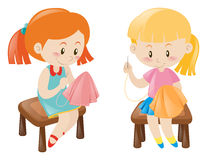 Two girl sewing handkerchief Stock Photography