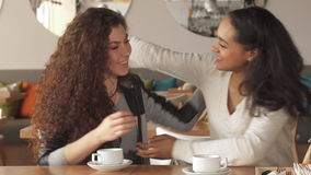 Two girl shows how they like each other at the cafe. Two pretty girls showing how they like each other at the cafe. Attractive caucasian woman hugging her friend stock video
