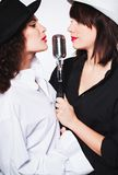 Two girl singers Royalty Free Stock Photos