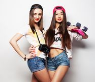 Two girl skaters Royalty Free Stock Image