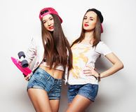 Two girl skaters Stock Photo