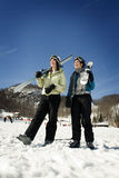 Two girl skiers hanging out Stock Images
