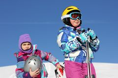 Two girl on the snow Royalty Free Stock Photo