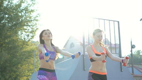 Two girl on the street fitness. 4K.  stock footage