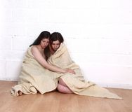 Two girl survivors of a natural disaster Royalty Free Stock Photos