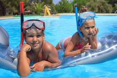 Two girl in the swimming pool. With diving mask Royalty Free Stock Images