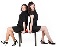Two girl on table Stock Photography