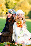 Two girl under the maple Stock Photography