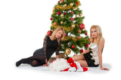 Two girl waiting santa near christmas tree Stock Image