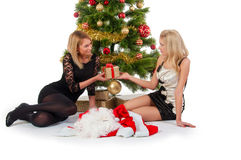 Two girl waiting santa near christmas tree Royalty Free Stock Photos