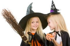 Two girl witches Stock Photos
