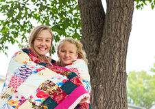 Two Girl Wrapped Quilt Royalty Free Stock Photo