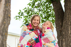 Two Girl Wrapped Quilt Stock Photo