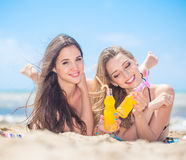 Two girlfriend on the beach Stock Image