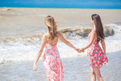 Two girlfriend on the beach Stock Photo