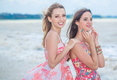 Two girlfriend on the beach Royalty Free Stock Photo