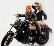Two girlfriend on a motorbike. The fan of heavy metal royalty free stock photos