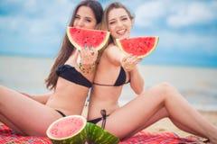 Two girlfriend on the summer beach Stock Photos