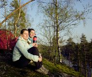 Two girlfriend on top of mountain camping Stock Photography