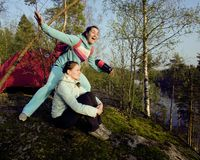 Two girlfriend on top of mountain camping Stock Images