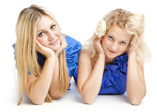 Two girlfriends. Two young girlfriends. Isolated on white background Stock Image