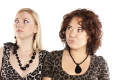 Two girlfriends. Two beautiful amazed girls on white background Stock Photography