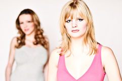 Two girlfriends. In front of a white background Stock Photo