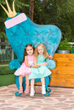 Two girlfriends. Adorable little children on happy birthday. Kid in park stock photo