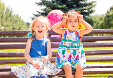 Two girlfriends. Adorable little children stock images