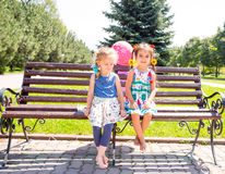 Two girlfriends. Adorable little children royalty free stock photos