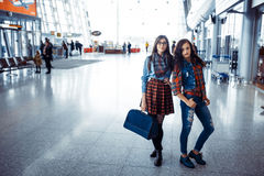 Two girlfriends at the airport waiting for the flight.Art proces Stock Photography
