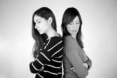 Two girlfriends angry to each other B&W. Two girlfriends angry not talking to each other not looking B&W Stock Photos