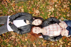 Two girlfriends at the autumn park. Stock Image