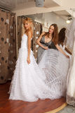 Two girlfriends in bridal Boutique Stock Image