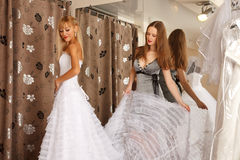 Two girlfriends in bridal Boutique Stock Photos