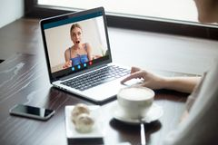Two girlfriends chatting on laptop via video call application. stock images
