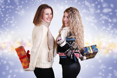 Two girlfriends with chrisnmas presents Royalty Free Stock Photo