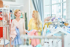 Two girlfriends in a clothing store Stock Photo