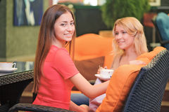 Two girlfriends communicating in cafe Royalty Free Stock Images