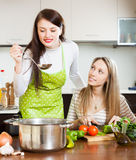 Two girlfriends cooking something Royalty Free Stock Photo